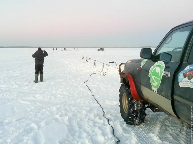 Pulling Land Cruiser From Under the Ice