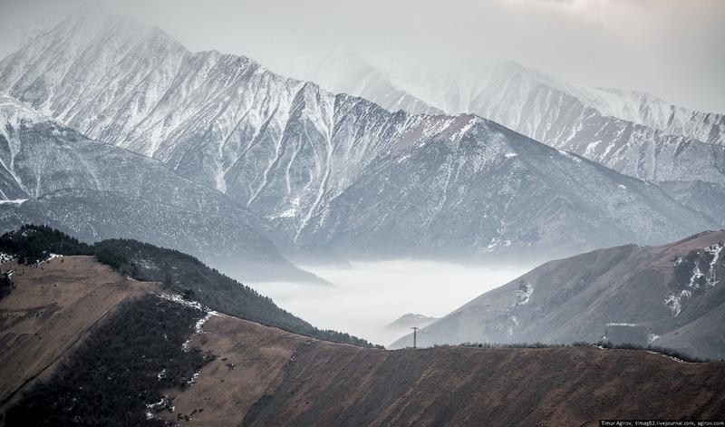 Morning fog walking down the mountain slopes