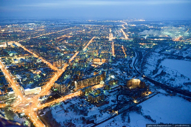 Flying Over the Winter City At Twilight