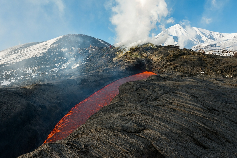 Flying Over the Volcano Spitting With Lava