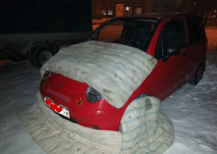 Girl Keeps Her Car Warm In Winter