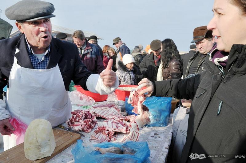 Tasting Pork At The Transcarpathian Festival In Geche