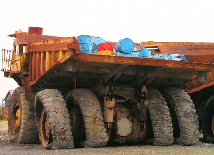 abandoned heavy trucks, komatsu, caterpilar, cat 11