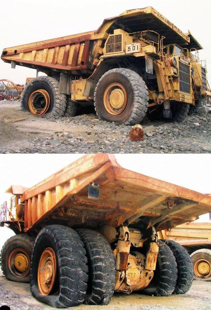 abandoned heavy trucks, komatsu, caterpilar, cat 12