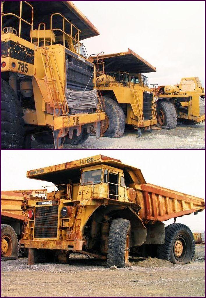 abandoned heavy trucks, komatsu, caterpilar, cat 14