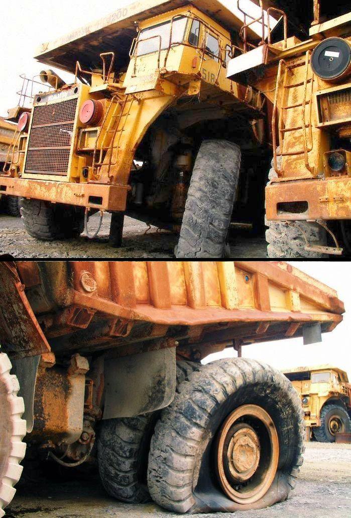 abandoned heavy trucks, komatsu, caterpilar, cat 20