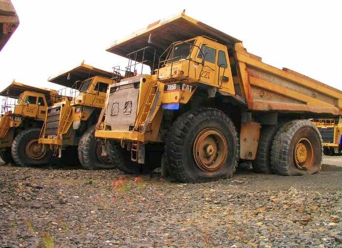 abandoned heavy trucks, komatsu, caterpilar, cat 4