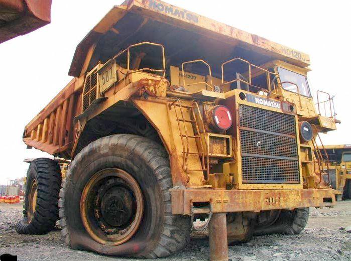 abandoned heavy trucks, komatsu, caterpilar, cat 6