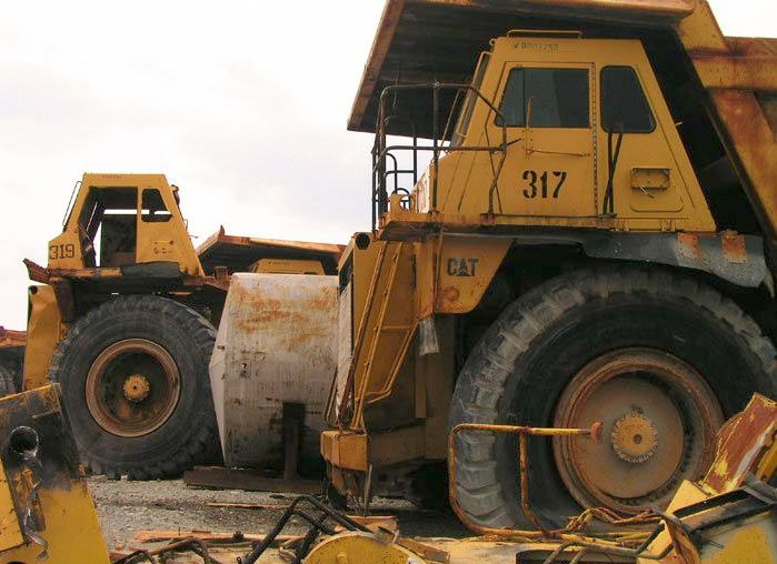 abandoned heavy trucks, komatsu, caterpilar, cat 8