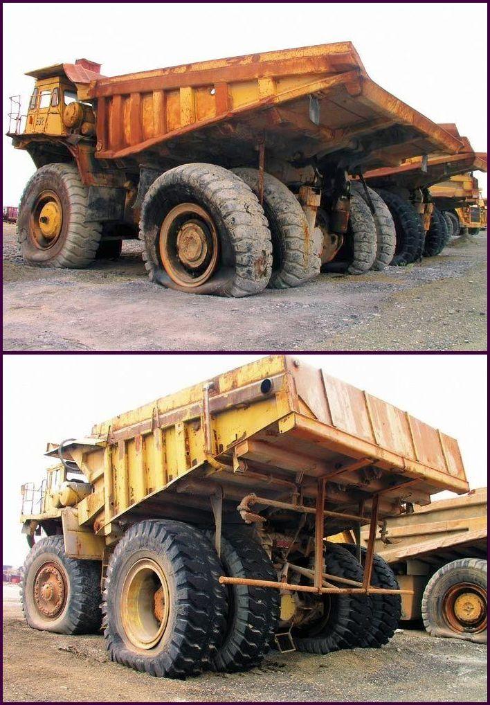 abandoned heavy trucks, komatsu, caterpilar, cat 9