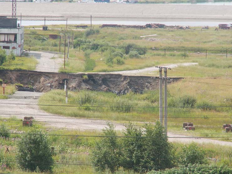 a giant hole in the land in Russian town 12