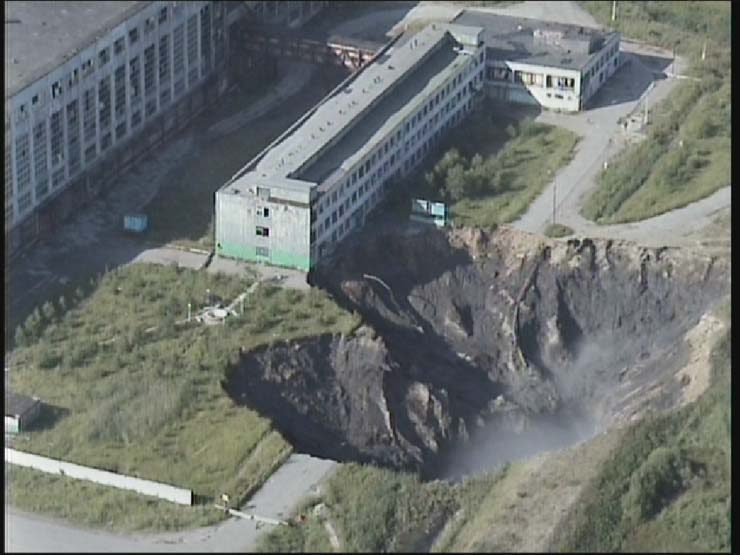 a giant hole in the land in Russian town 3