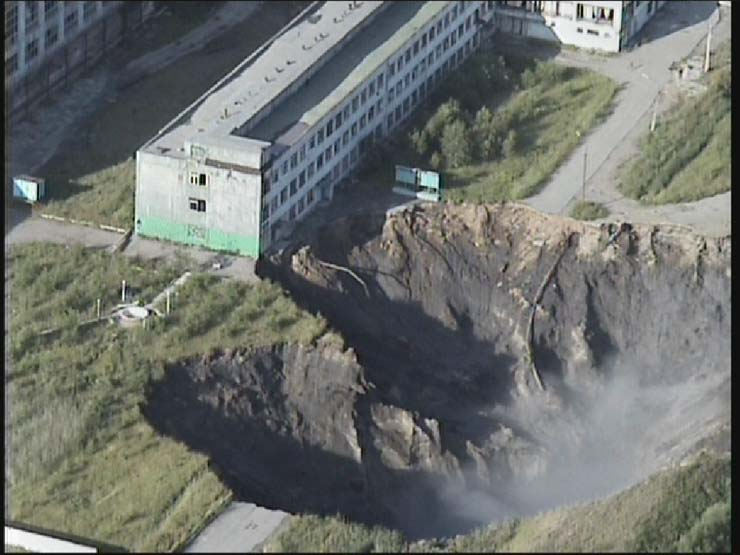 a giant hole in the land in Russian town 4
