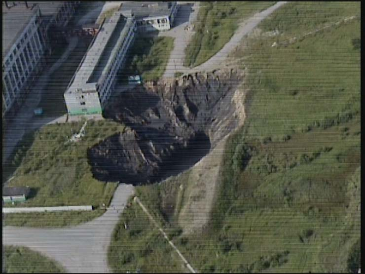a giant hole in the land in Russian town 5