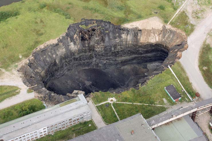 a giant hole in the land in Russian town 7