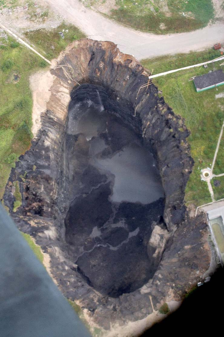 a giant hole in the land in Russian town 8