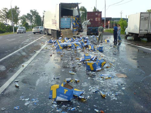 russian truck crashes pile of beer