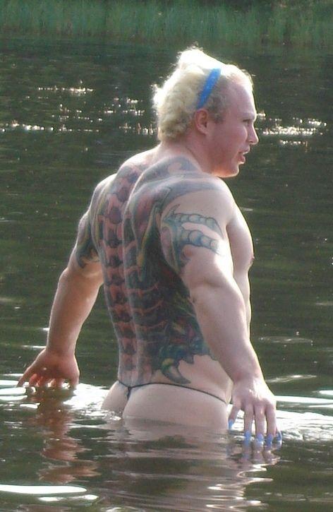 strange bodybuilder was spotted on the lake shore 6