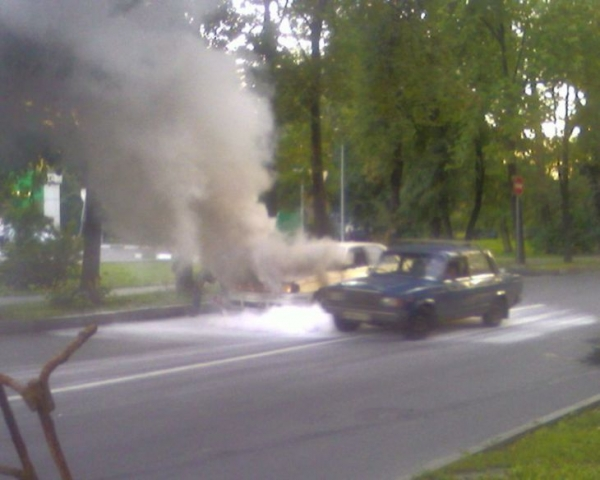 the car has burst into flames straight on the road 1