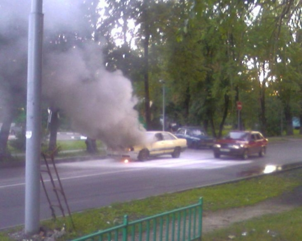 the car has burst into flames straight on the road 2