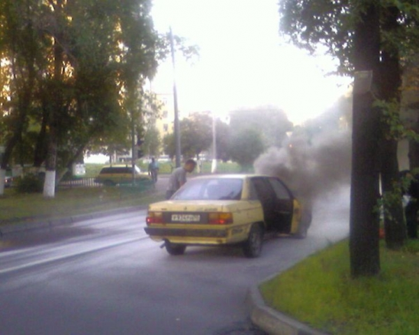 the car has burst into flames straight on the road 5
