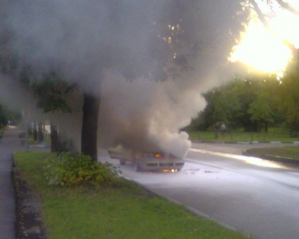 the car has burst into flames straight on the road 6