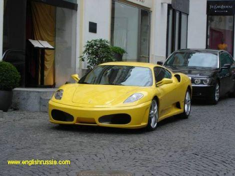 yellow ferrari and bmw