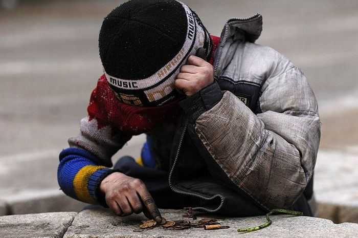 Russian boy collects coins 3