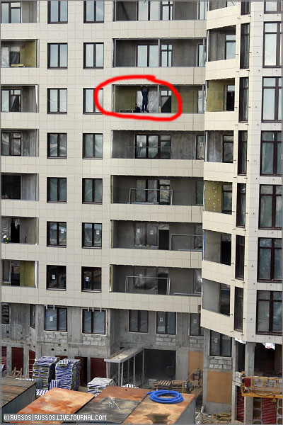 person stands on the high floor right on the window 1