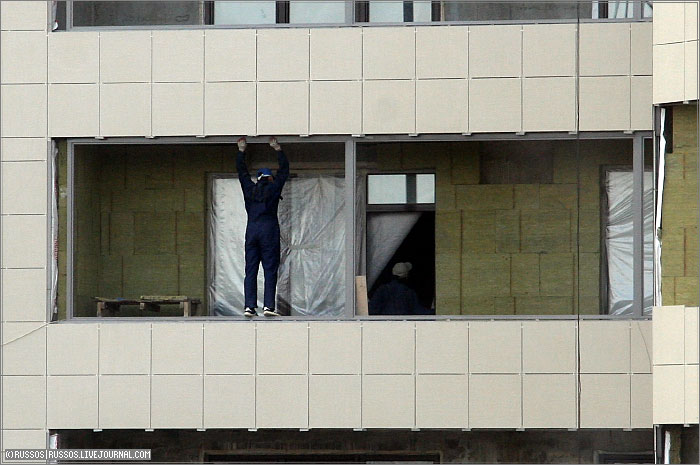 person stands on the high floor right on the window 2