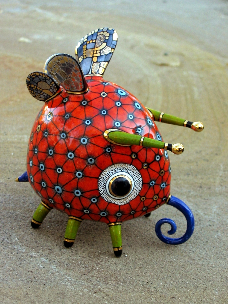 Ceramic Aliens And Wooden Crafts