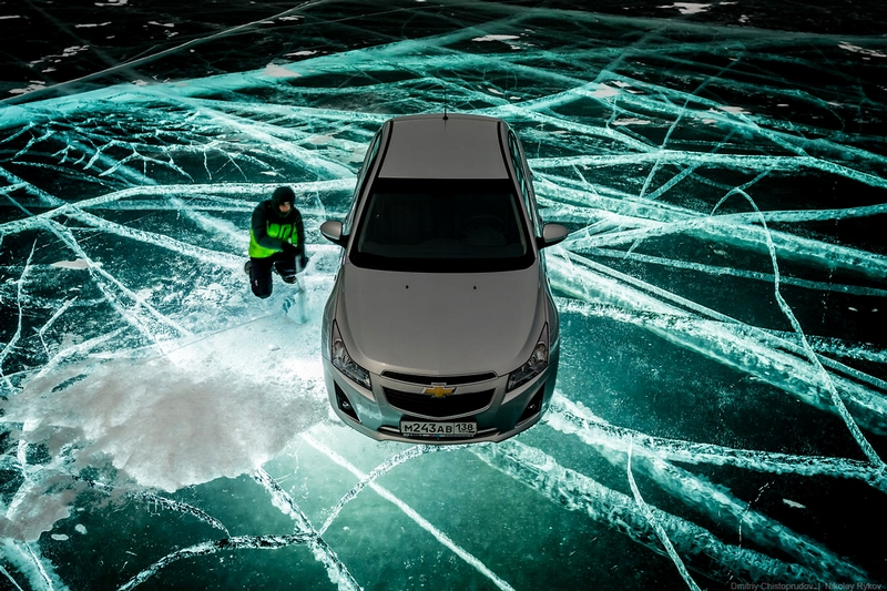 Car on Ice At Night Illuminated from Underwater