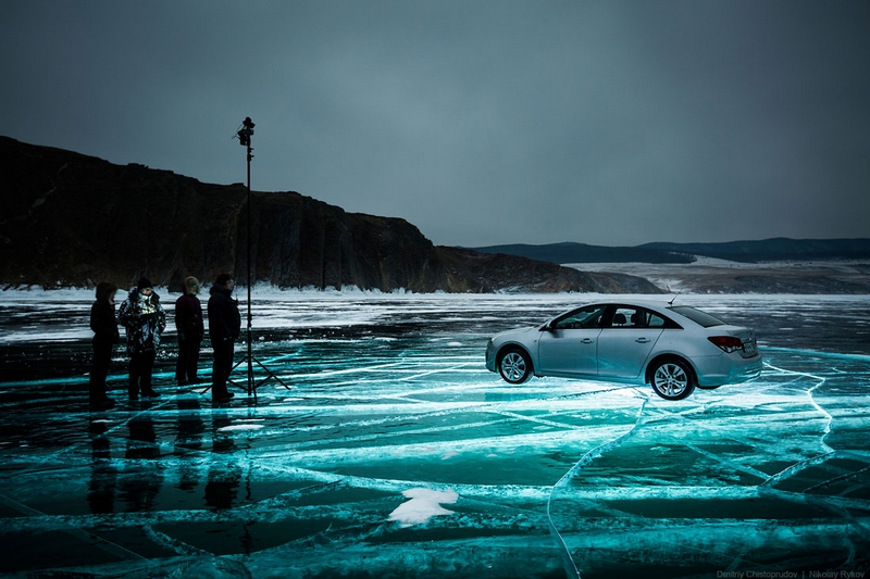 Car on Ice At Night Illuminated from Underwater