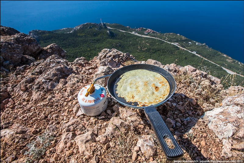 Making Russian Pancakes on top of Crimean Mountain