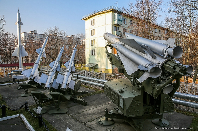 Air Defense Museum Stationed on the Street Next to Regular Houses