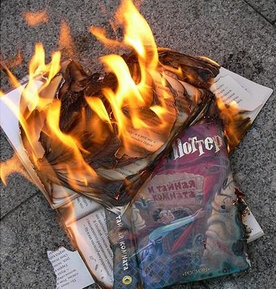 Russian guys burn Harry Potter books 3