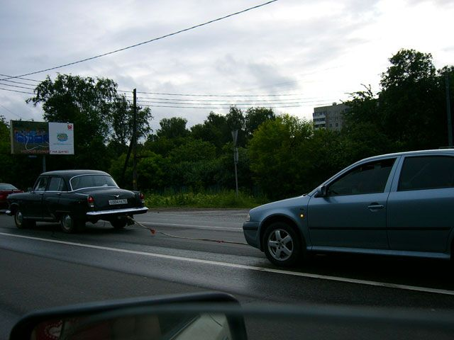 old car tows new car in Russia 4