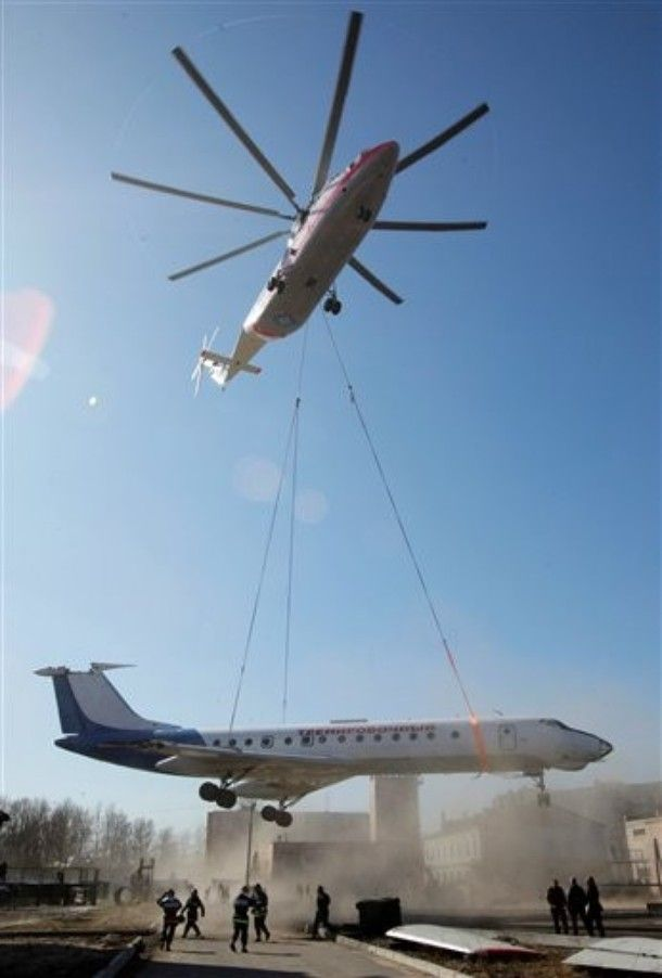 Helicopter tows plane