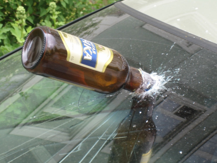beer bottle in the car frontal 1