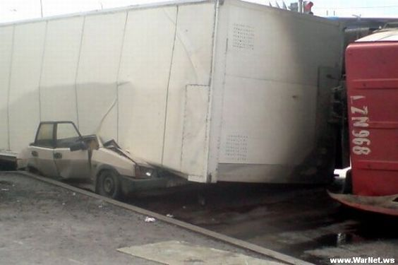 Russian car lada smashed by truck 1