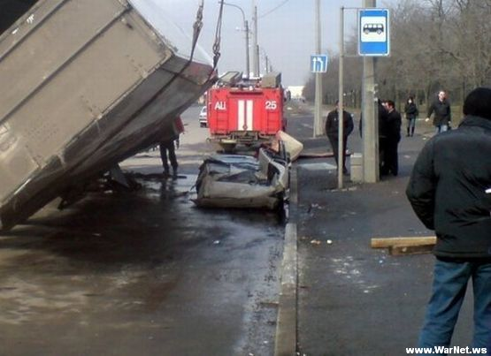 Russian car lada smashed by truck 3