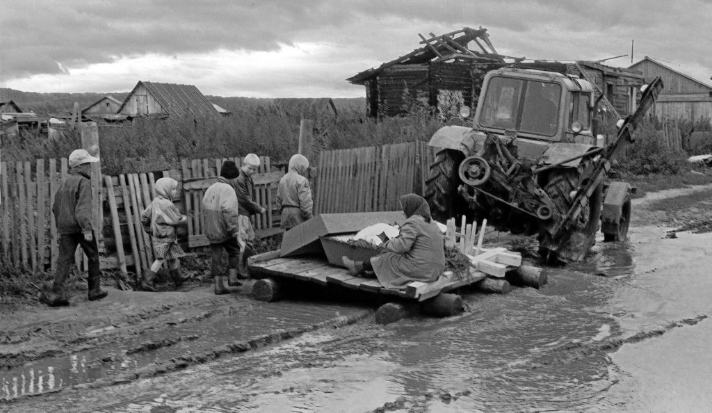 russian tractor towes raft