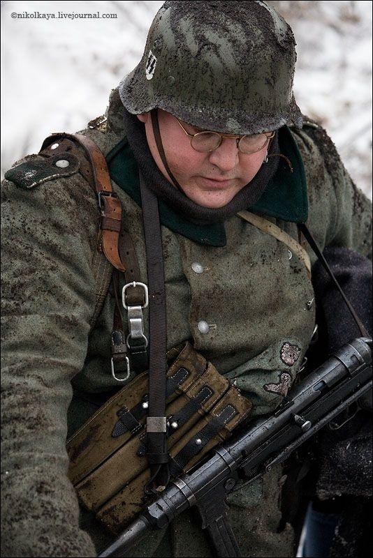 guys dressed in world war suites near Leningrad 38