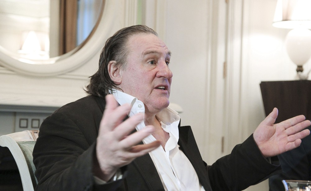 French actor Depardieu gestures during his meeting with Russian President Putin in Sochi