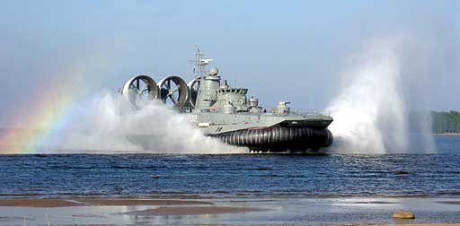 Landing Ship Scares People Resting On the Beach