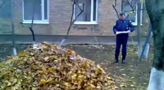 Policeman Sets Fire to the Leaves