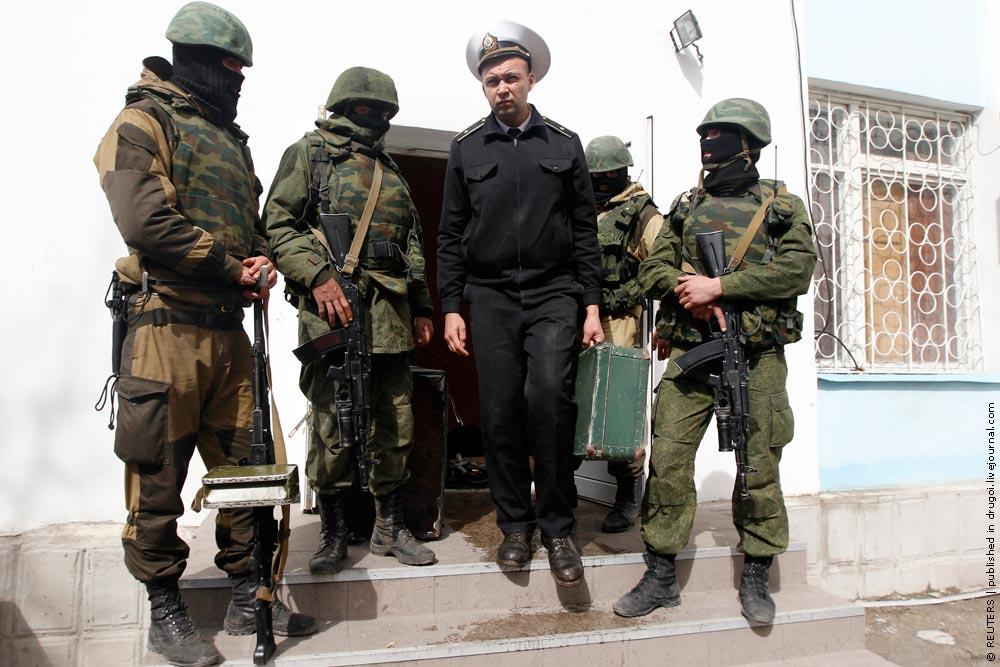 A Ukrainian naval officer leaves the naval headquarters in Sevastopol