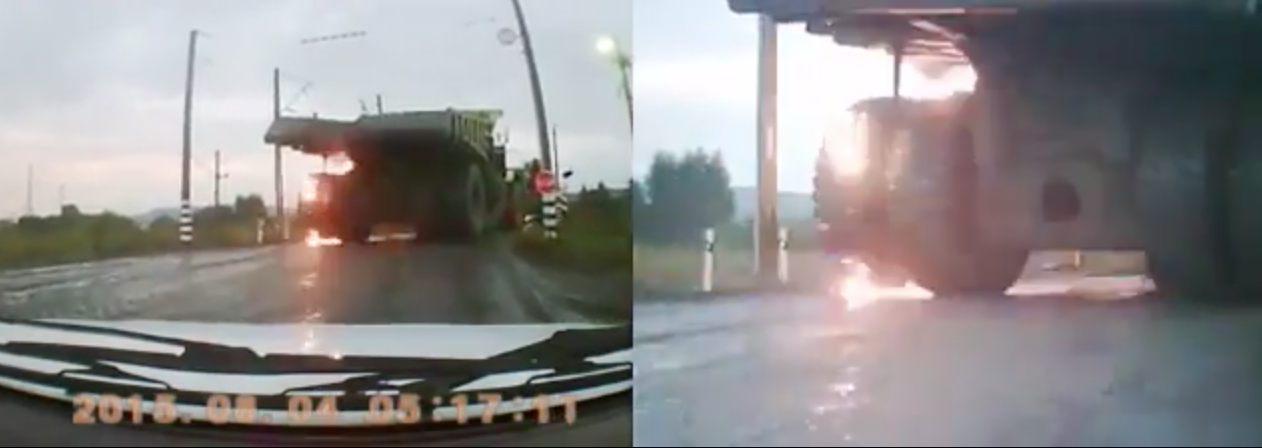 BELAZ Truck Tire Explodes on the Railroad Crossing