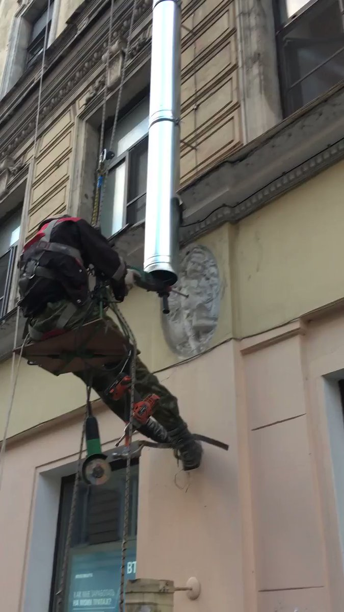 Man Drill 19th Century Building Decor to Put Drainage [video]