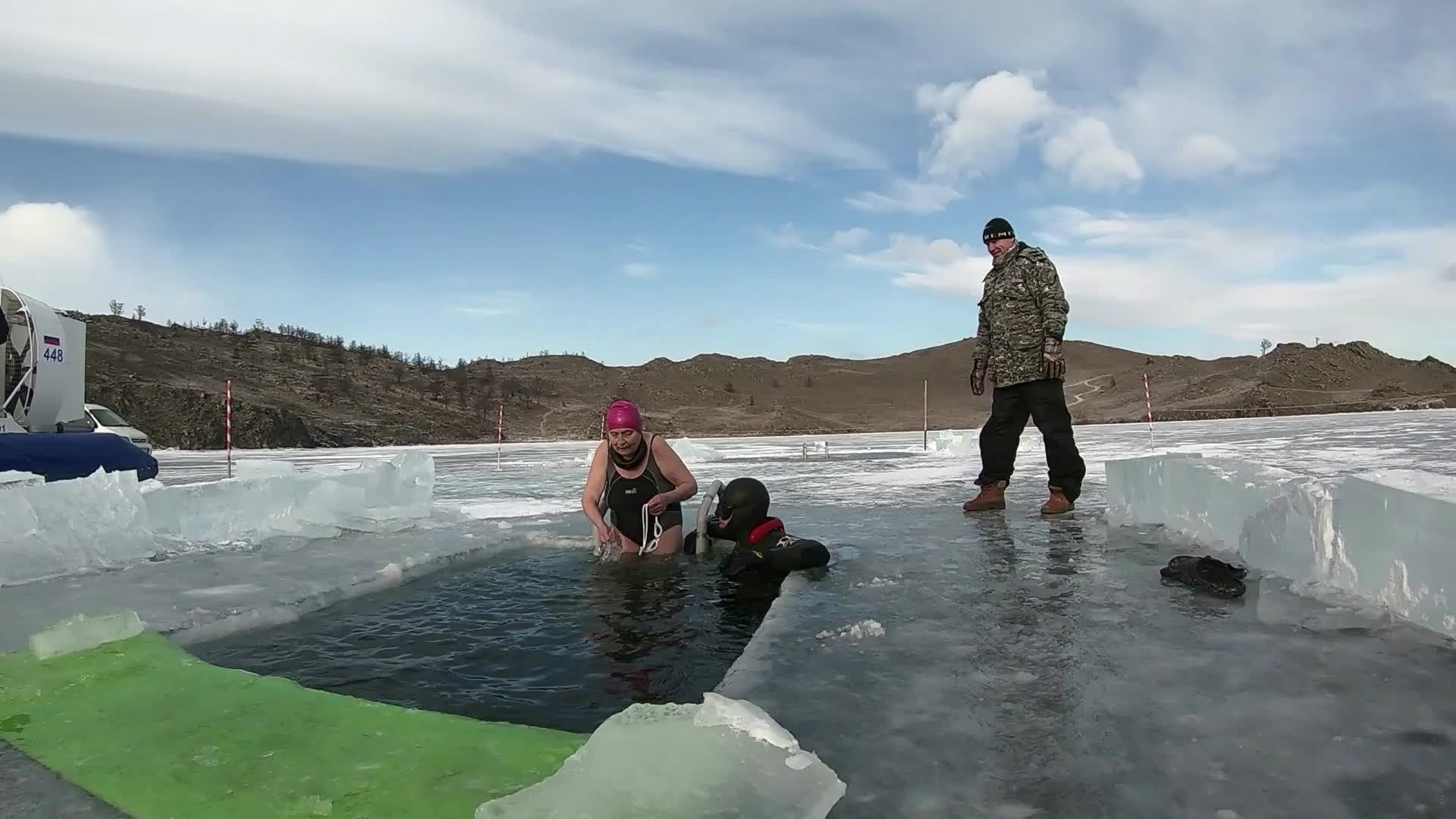 Woman Swims Under the Ice [video]